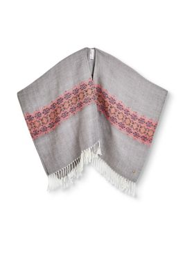 Soft poncho with fringing with an ornamental pattern and a melange texture